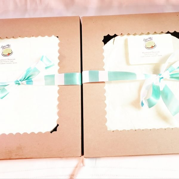 Vanilla cheesecake in a clear lid presentation box for delivery